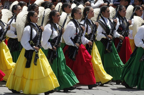 Female soldiers dressed in traditional clothing march during a military parade in culmination of bicentennial celebrations in Mexico City