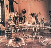 ca1900RecliningonaTableinSalon
